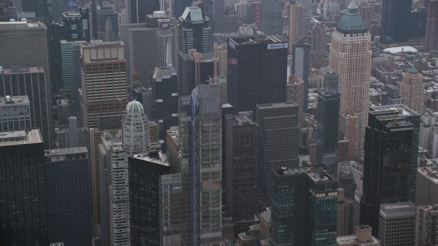 6K stock footage aerial video of an orbit of the One57 skyscraper and reveal Times Square in Midtown, New York City Aerial Stock Footage | AX120_168
