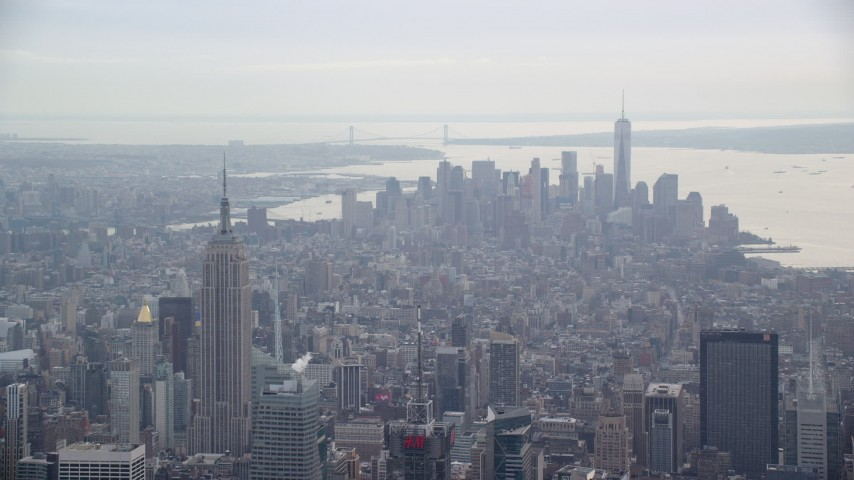6K stock footage aerial video of a view of the Empire State Building and Lower Manhattan skyscrapers, New York City Aerial Stock Footage | AX120_170
