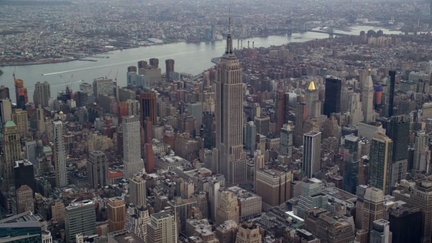 6K stock footage aerial video orbit Empire State Building and skyscrapers in Midtown, New York City Aerial Stock Footage | AX120_173