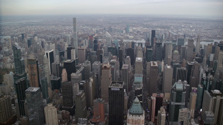 6K stock footage aerial video of orbiting Midtown Manhattan skyscrapers in New York City Aerial Stock Footage | AX120_175