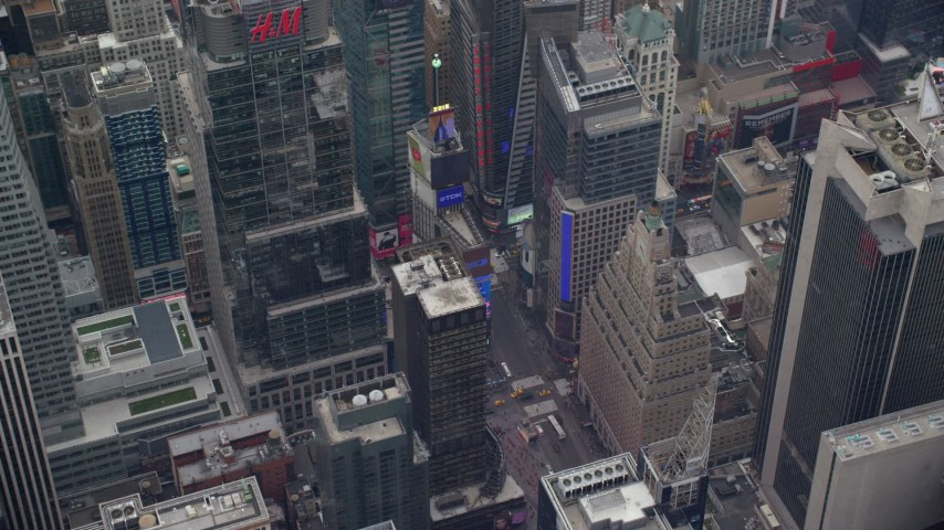 6K stock footage aerial video orbit video screens in Times Square, Midtown, New York City Aerial Stock Footage | AX120_182