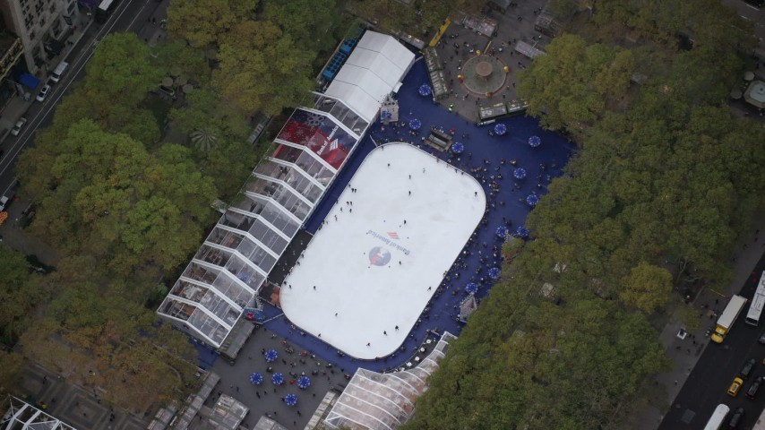 6K stock footage aerial video of a bird's eye of ice skating rink at Bryant Park, Midtown, New York City Aerial Stock Footage | AX120_183