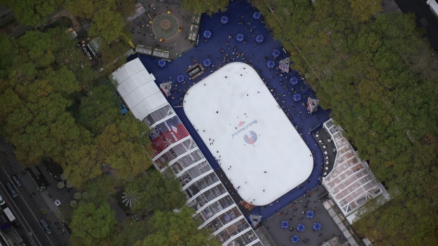 6K stock footage aerial video of a bird's eye orbit of the ice skating rink at Bryant Park, Midtown, New York City Aerial Stock Footage | AX120_184