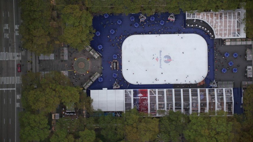 Bird's Eye of the Ice Skating Rink at Bryant Park, Midtown, New York City Aerial Stock Footage | AX120_185