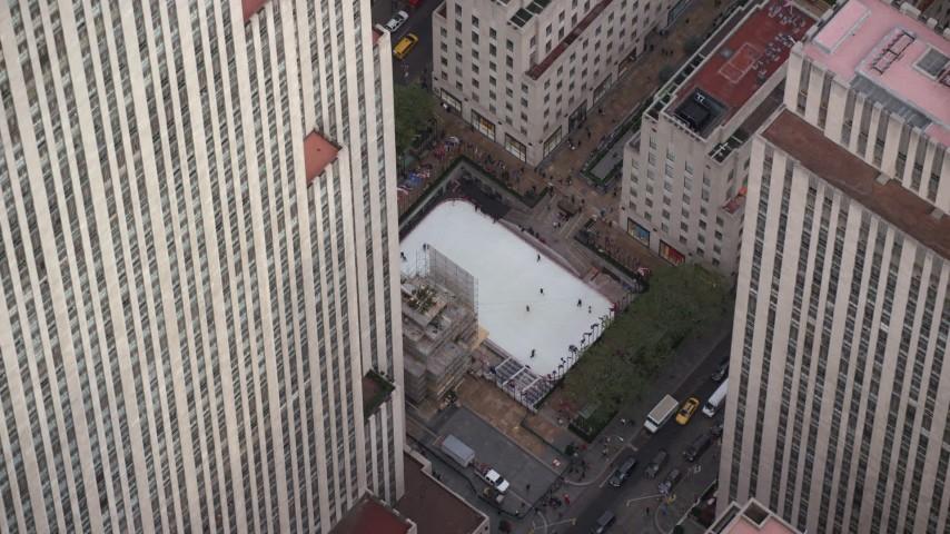6K stock footage aerial video orbit ice rink at Rockefeller Center, Midtown, New York City Aerial Stock Footage   AX120_186