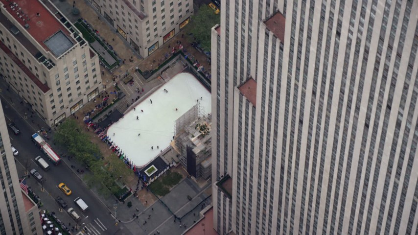 6K stock footage aerial video orbit ice rink at Rockefeller Center, Midtown, New York City Aerial Stock Footage | AX120_186E