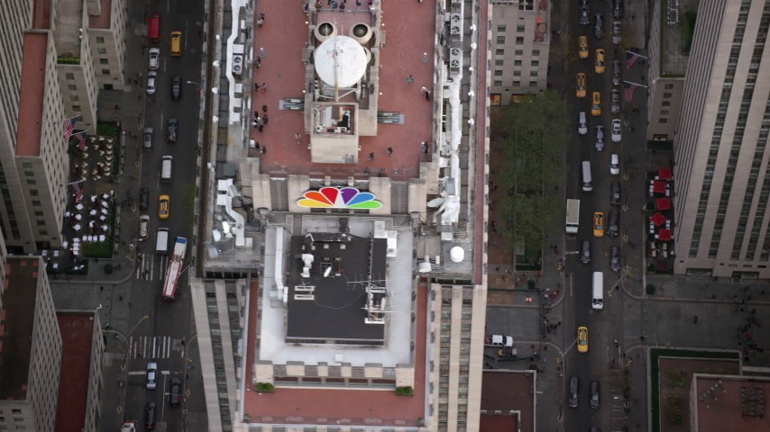6K stock footage aerial video orbit ice rink and skyscraper at Rockefeller Center, Midtown, New York City Aerial Stock Footage | AX120_187