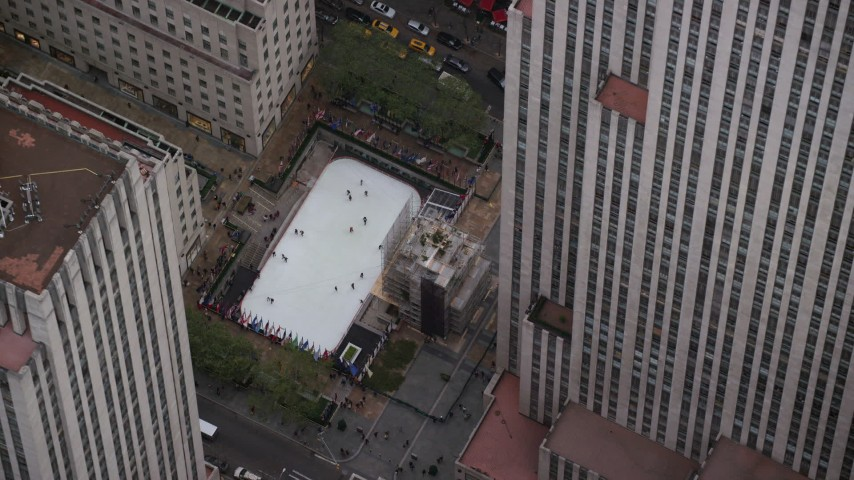 6K stock footage aerial video of circling the ice skating rink at Rockefeller Center in Midtown, New York City Aerial Stock Footage | AX120_188