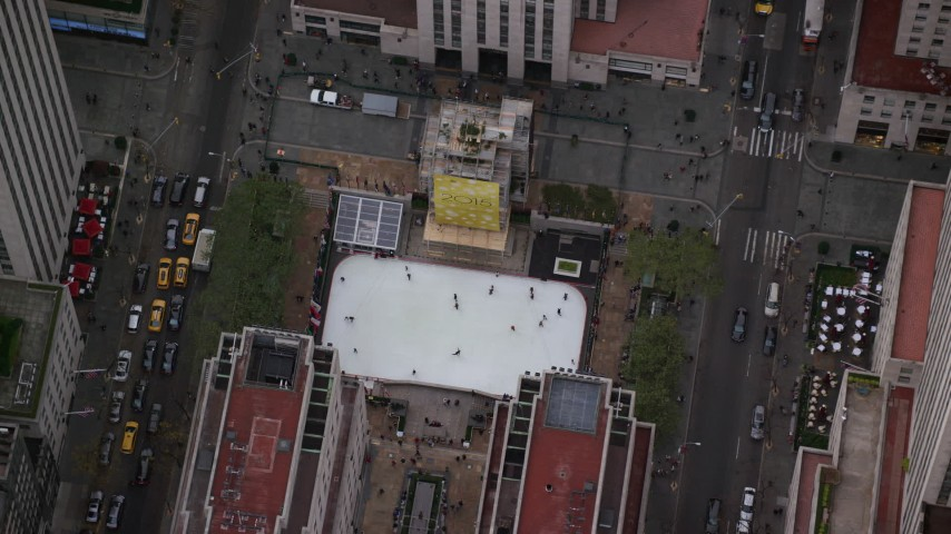 6K stock footage aerial video orbit Rockefeller Center ice rink in Midtown, New York City Aerial Stock Footage | AX120_190
