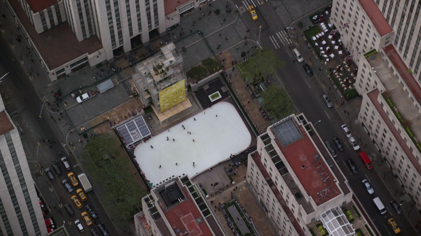 6K stock footage aerial video of skaters at the Rockefeller Center ice skating rink in Midtown, New York City Aerial Stock Footage   AX120_191