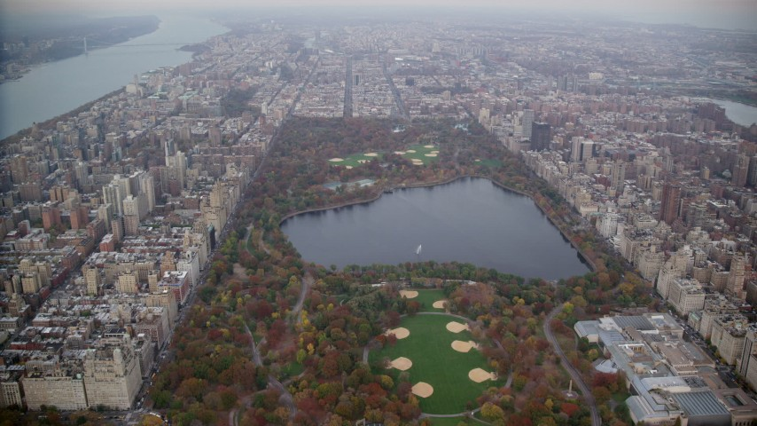 6K stock footage aerial video approach reservoir in Central Park in Autumn, New York City Aerial Stock Footage | AX120_196