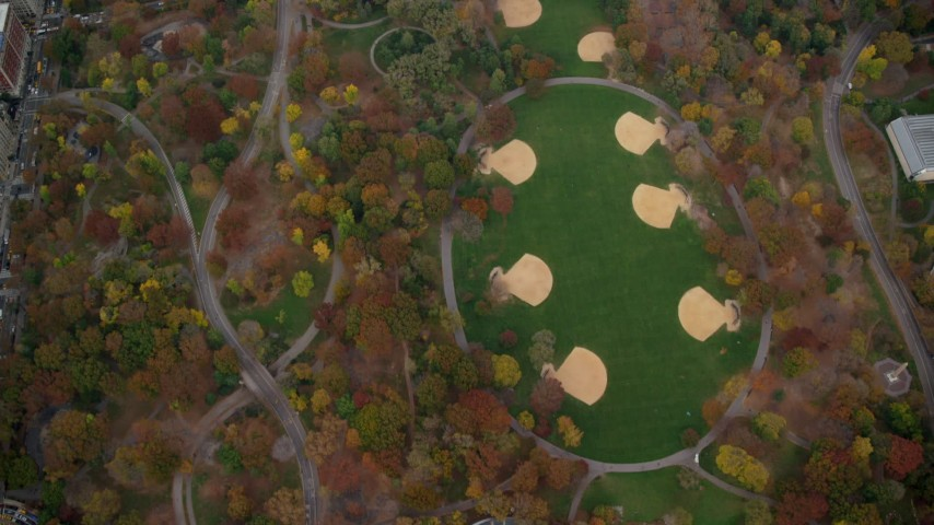 6K stock footage aerial video of bird's eye of a theater and baseball diamonds in Central Park in Autumn, New York City Aerial Stock Footage AX120_197 | Axiom Images