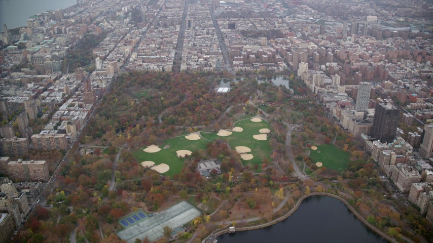 6K stock footage aerial video approach baseball diamonds in Central Park in Autumn, New York City Aerial Stock Footage | AX120_198
