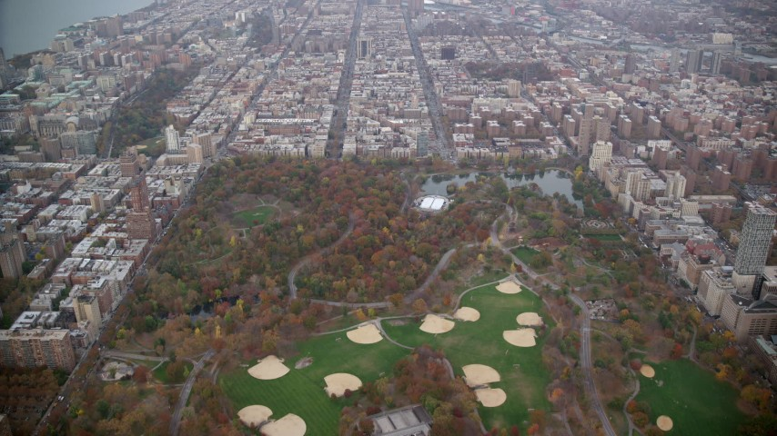 6K stock footage aerial video approach baseball diamonds and Lasker Rink in Central Park, New York City Aerial Stock Footage | AX120_199