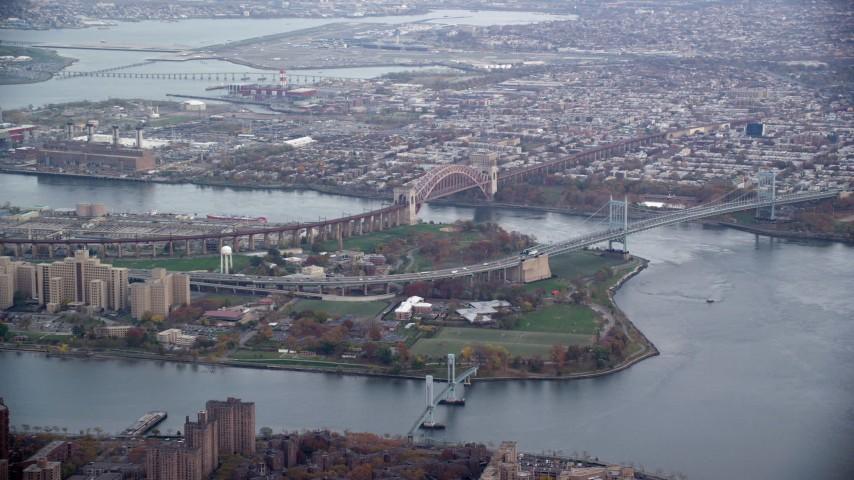 6K stock footage aerial video of Robert F Kennedy Bridge and Hell Gate Bridge on Wards Island, New York City Aerial Stock Footage AX120_200