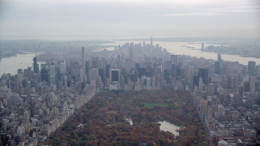 6K stock footage aerial video of Midtown high-rises seen from Central Park, New York City Aerial Stock Footage | AX120_205