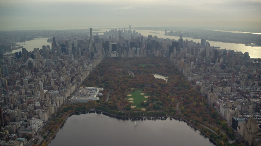 6K stock footage aerial video fly over Central Park toward Midtown in Autumn, New York City Aerial Stock Footage | AX120_210E