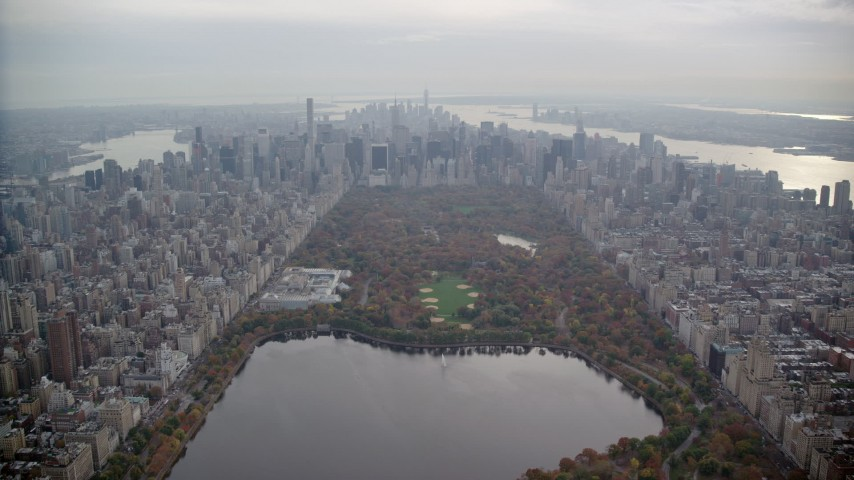 6K stock footage aerial video fly over Central Park toward The Met and Midtown in Autumn, New York City Aerial Stock Footage | AX120_211