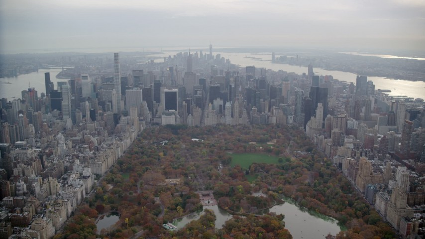 6K stock footage aerial video approach Midtown skyscrapers from Central Park in Autumn, New York City Aerial Stock Footage | AX120_214