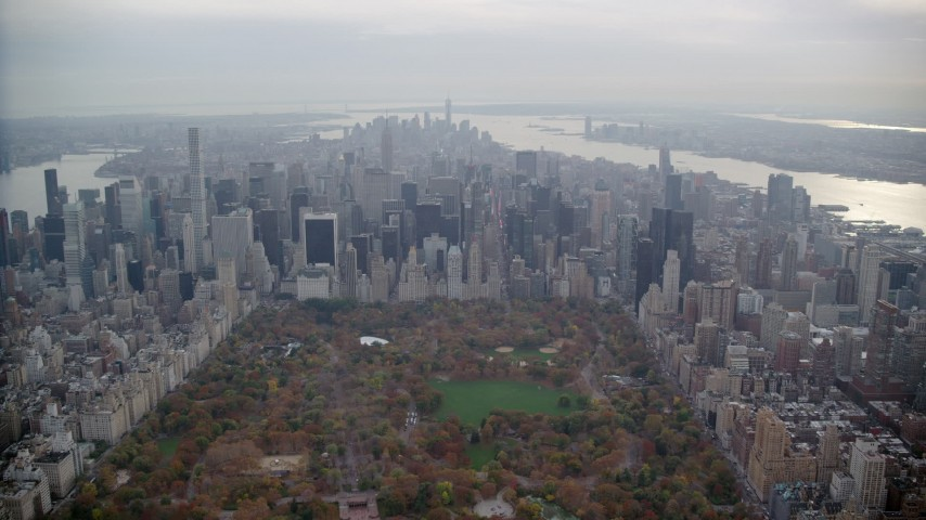 6K stock footage aerial video of Midtown high-rises viewed from Central Park in Autumn, New York City Aerial Stock Footage | AX120_215