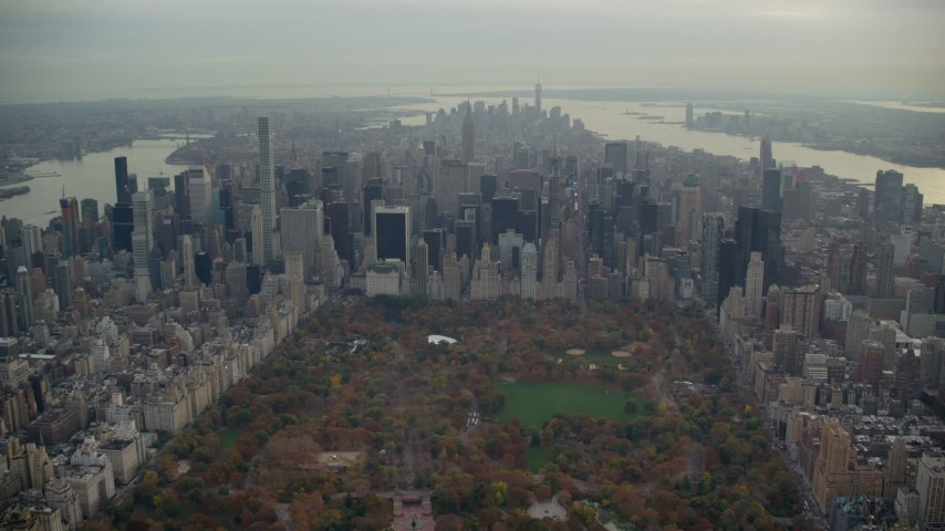 6K stock footage aerial video fly over Central Park and approach Midtown in Autumn, New York City Aerial Stock Footage | AX120_219E