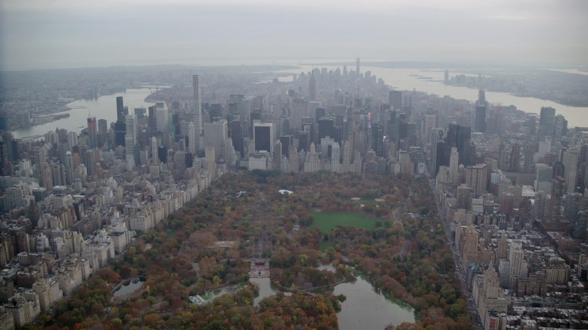 6K stock footage aerial video approach Midtown and fly over Central Park in Autumn, New York City Aerial Stock Footage | AX120_220