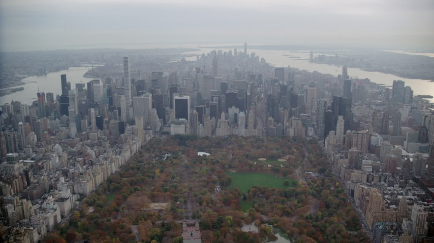 6K stock footage aerial video of flying over Central Park toward Midtown Manhattan in Autumn, New York City Aerial Stock Footage | AX120_221