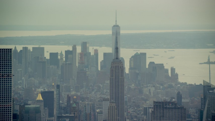 6K stock footage aerial video of the top of the Empire State Building and Lower Manhattan, New York City Aerial Stock Footage | AX120_225E