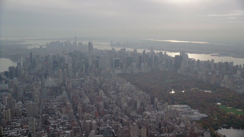 Slow Approach to Midtown and Central Park from Upper East Side, New York City Aerial Stock Footage | AX120_230