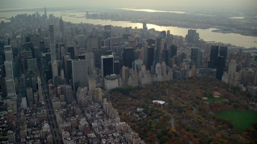 6K stock footage aerial video approach Midtown bordering Central Park in Autumn, New York City Aerial Stock Footage | AX120_233