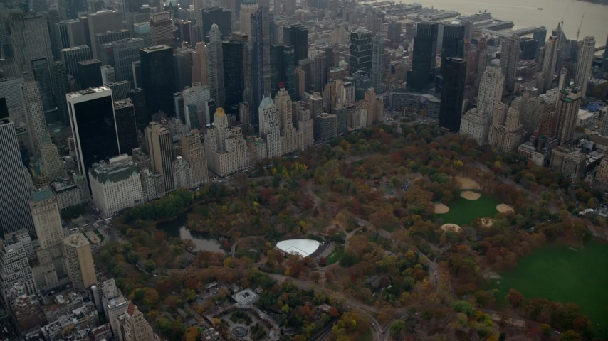 6K stock footage aerial video approach Wollman Rink in Central Park in Autumn, New York City Aerial Stock Footage | AX120_234