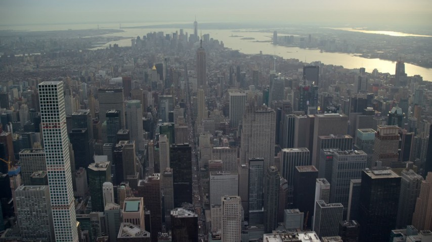 6K stock footage aerial video fly over Midtown toward Empire State Building, New York City Aerial Stock Footage | AX120_235