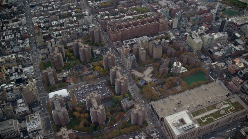 6K aerial video approach Penn South apartment buildings in Chelsea in Autumn, New York City Aerial Stock Footage | AX120_238