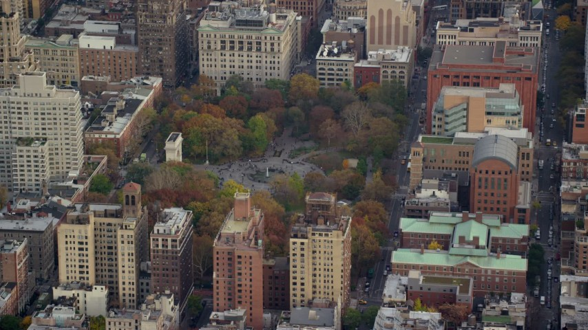 6K stock footage aerial video orbit Washington Square Park in Autumn, Greenwich Village, New York City Aerial Stock Footage AX120_243 | Axiom Images