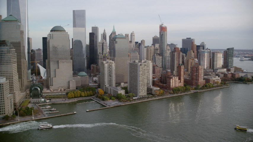 6K stock footage aerial video orbit riverfront WTC and Lower Manhattan skyscrapers in New York City Aerial Stock Footage | AX120_248