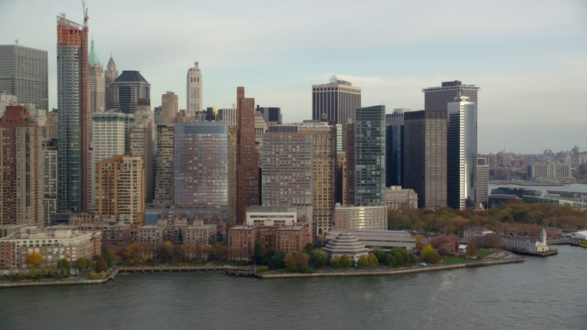 Battery Park and Riverfront High-Rises in Autumn, Lower Manhattan, New York City Aerial Stock Footage | AX120_249