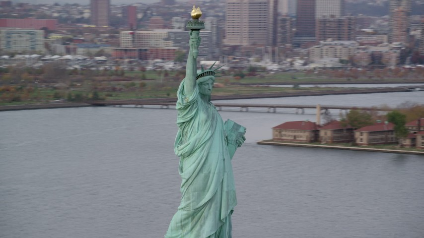 Orbit Front of Statue of Liberty in Autumn, New York Aerial Stock Footage | AX120_255