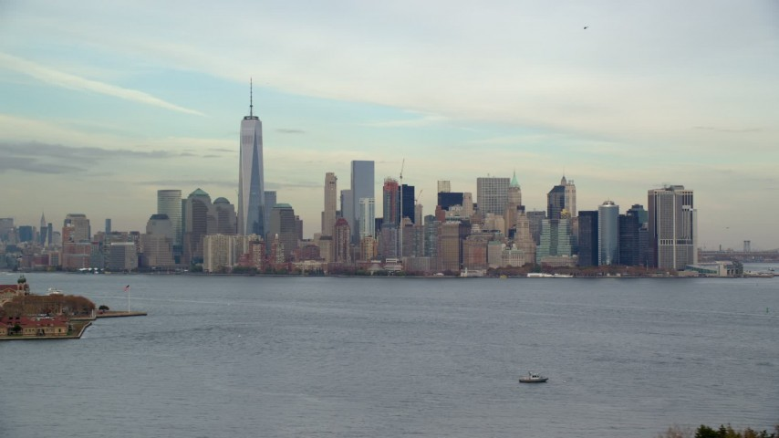 6K stock footage aerial video of a wide view of Lower Manhattan seen from Ellis Island in Autumn, New York City Aerial Stock Footage | AX120_257