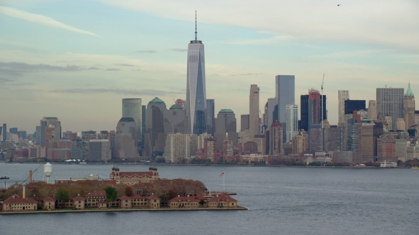 6K stock footage aerial video of Ellis Island and Lower Manhattan skyline in Autumn, New York City Aerial Stock Footage | AX120_258