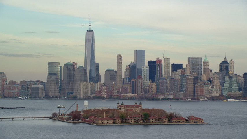 6K stock footage aerial video orbit Ellis Island and Lower Manhattan skyline in Autumn, New York City Aerial Stock Footage | AX120_259E