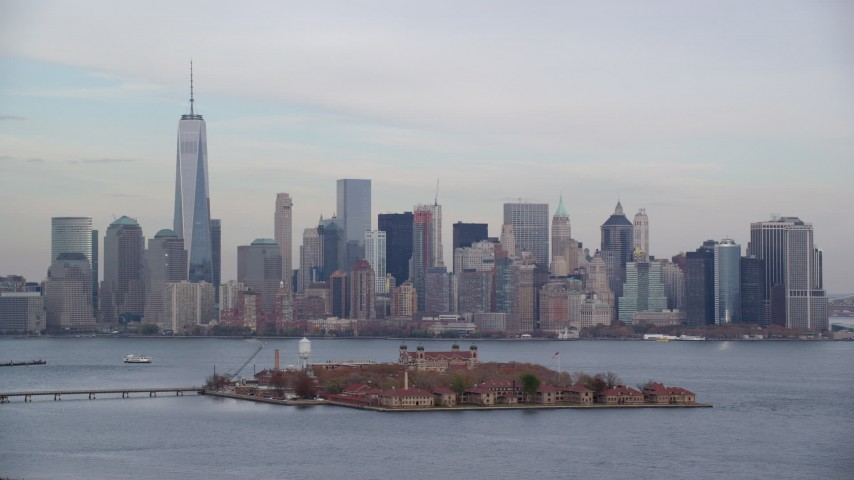 6K stock footage aerial video orbiting Ellis Island and Lower Manhattan skyline in Autumn, New York City Aerial Stock Footage | AX120_260