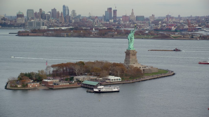 6K stock footage aerial video orbit Liberty Island and Statue of Liberty in Autumn, New York Aerial Stock Footage | AX120_262