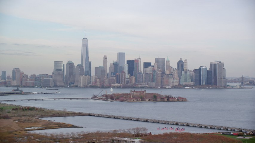 6K stock footage aerial video of Lower Manhattan skyline and Ellis Island in Autumn, New York City Aerial Stock Footage   AX120_263