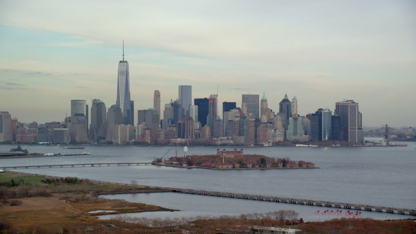 6K stock footage aerial video of Lower Manhattan skyline and Ellis Island in Autumn, New York City Aerial Stock Footage   AX120_263E