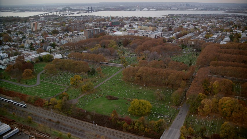 6K aerial video approach cemetery in Autumn, Jersey City, New Jersey Aerial Stock Footage | AX120_266
