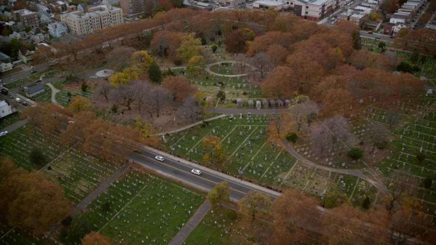 6K stock footage aerial video fly over tombs and gravestones at a cemetery in Autumn, Jersey City, New Jersey Aerial Stock Footage | AX120_267