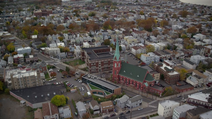 6K stock footage aerial video orbit a church and high school in Autumn, Jersey City, New Jersey Aerial Stock Footage | AX120_268