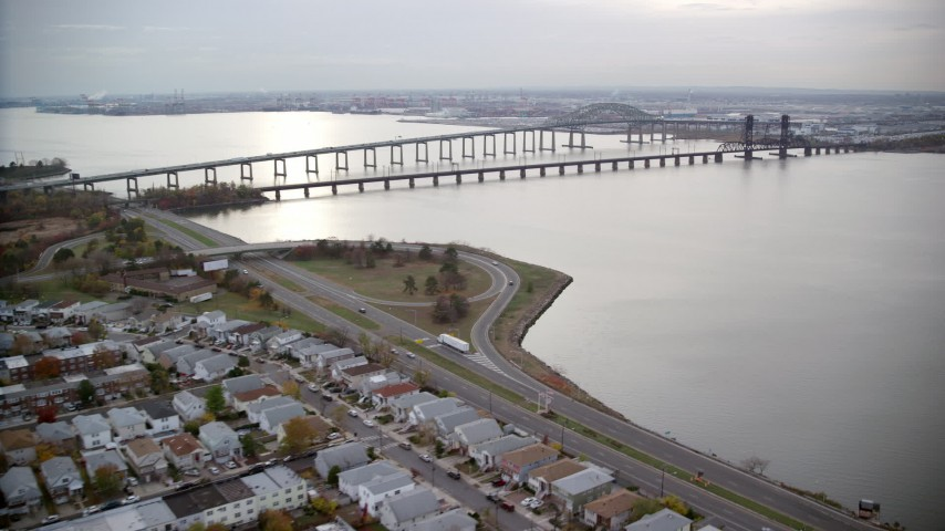 6K stock footage aerial video of bridges over Newark Bay in Autumn, Jersey City, New Jersey Aerial Stock Footage | AX120_270