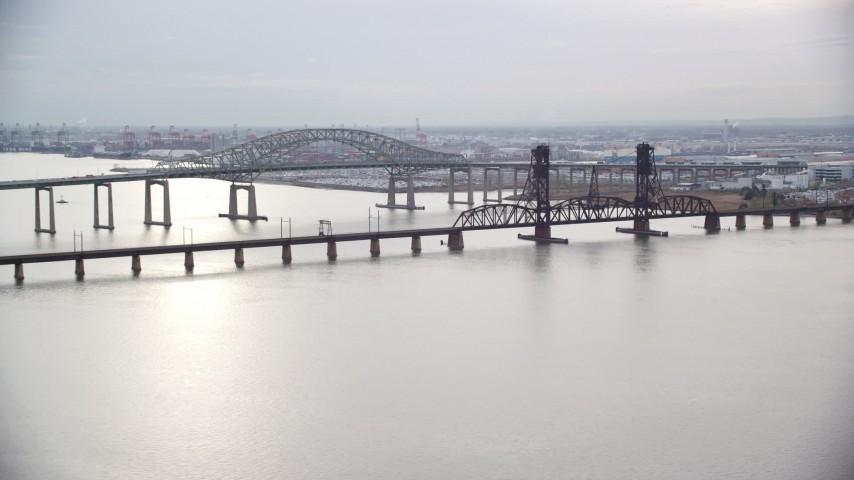 6K stock footage aerial video orbit bridges spanning Newark Bay in Autumn, New Jersey Aerial Stock Footage   AX120_271