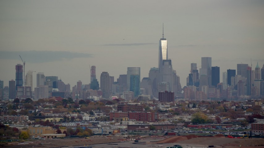 6K stock footage aerial video of the Lower Manhattan skyline seen from New Jersey in Autumn Aerial Stock Footage | AX120_273